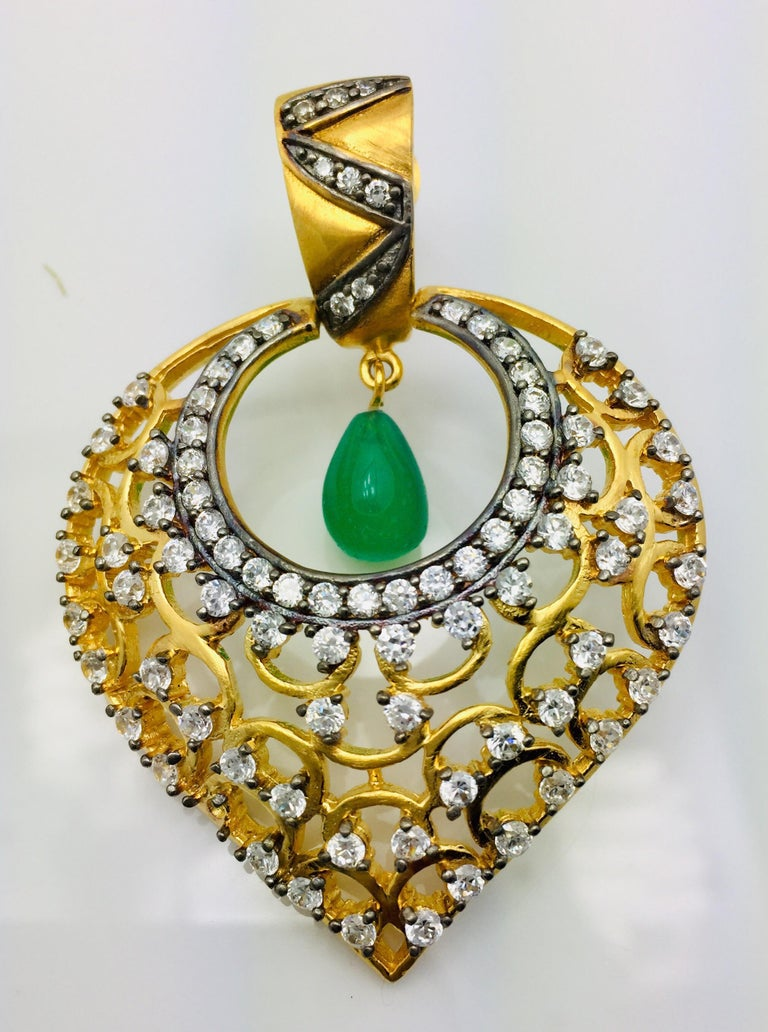 Gold Leaf enhanced by dozens of twinkling CZ stones and faux emerald drop earrings. These earrings hit all the trends in an elegantly beautiful way. Earrings have a post closure for pierced ears.   A small video can be requested.  Metal: 18k gold