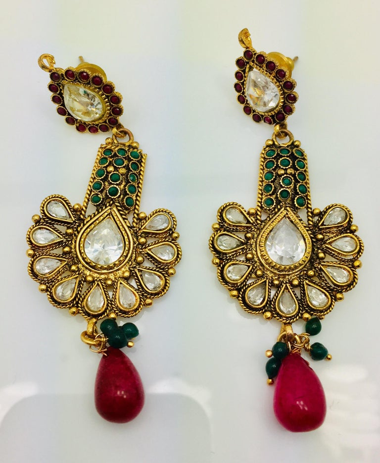The handmade antique style red & green earrings is ornate and lovely, it is further enhanced by sparkling CZ stones. Earrings have a post closure for pierced ears.   Length 2 1/2 inches  FOLLOW  MEGHNA JEWELS storefront to view the latest collection
