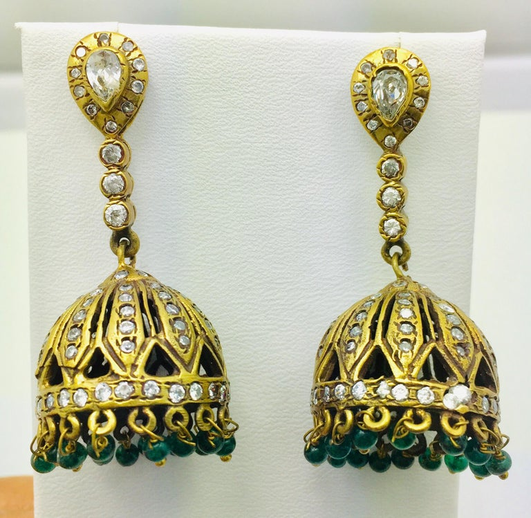 This dome shaped tassel drop earrings is enhanced with green beads.  They have varying pave crystal embellishments  Let them swing above a lace blouse for a ladylike look.  A small video can be requested.  Metal: 18k gold plated  Stone: Green beads,