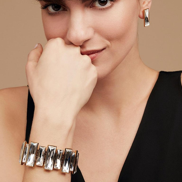 Striking Swarovski baguette crystals sparkle with every movement in their hand-crafted stone setting. A true statement of glamour. This luxurious statement bracelet sits delicately on your wrist, creating the perfect touch of sparkle for any