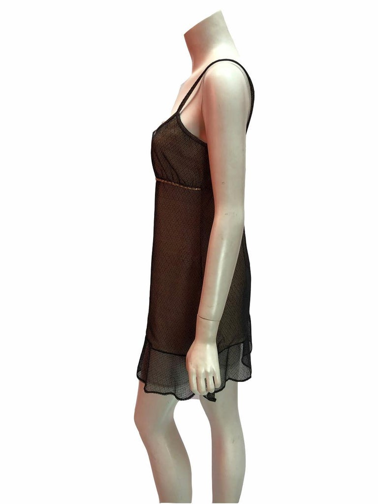 Chanel babydoll style slip dress in nude with black mesh overlay and chain accent under the bust. Spaghetti straps and ruffle bottom. Absolutely adorable. Size 8/10