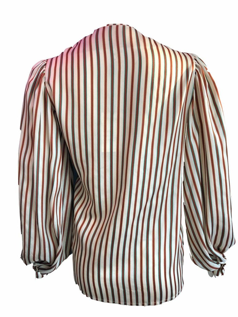Striped boxy blouse by Hermes in cream with maroon, yellow and green stripes. Features puffy sleeves and v neck. Excellent condition.  100% silk  Size 38