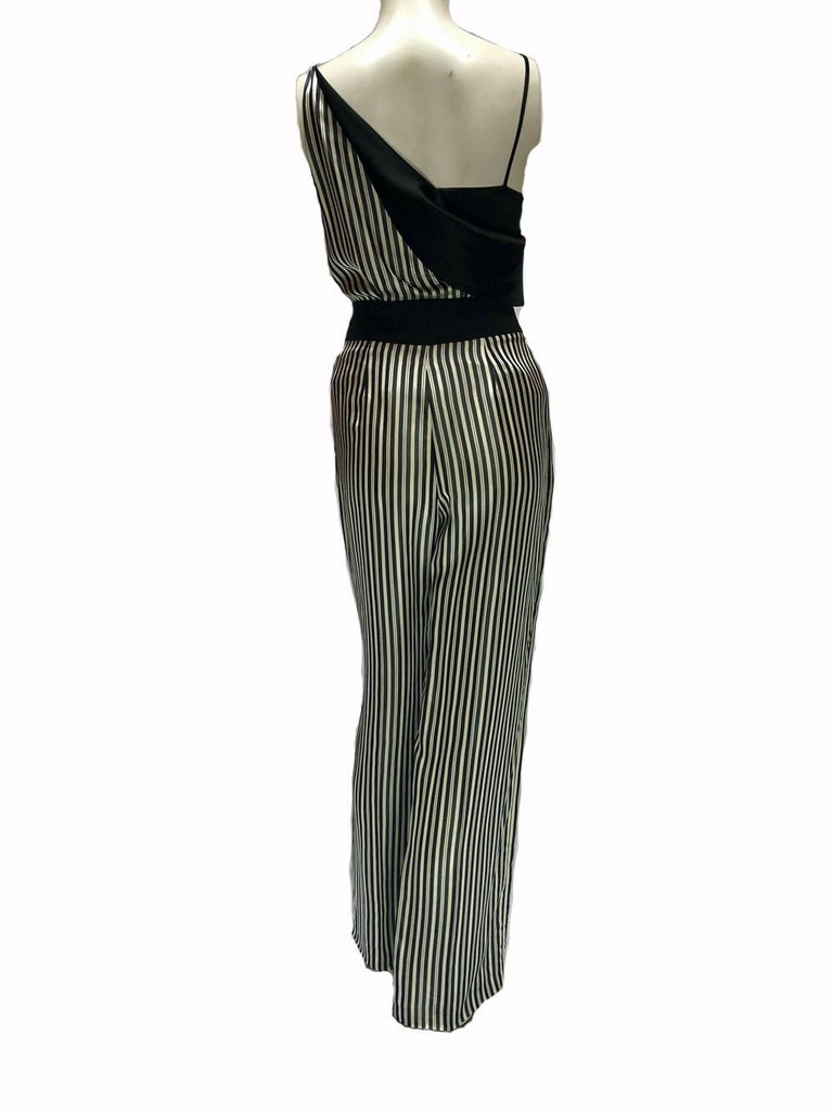 Lanvin silk, pin-striped, navy and white ensemble. Spaghetti strapped top, with flower and chain embellishment. This is special piece, in a beautiful fabric.  Please note the bottoms and top are a different size. Top is a size 34 and bottoms a 38.