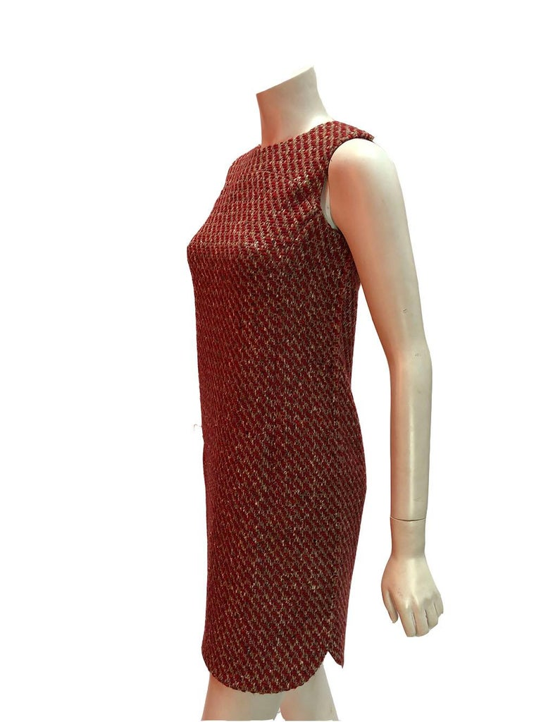 Sleeveless tweed shift dress by Loro Piana with back zip. The perfect layering piece for fall! New with original tags still attached. Size 40.