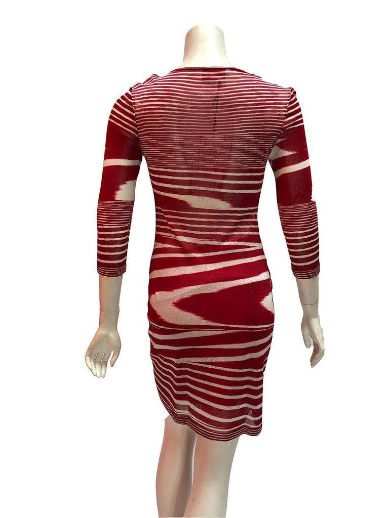 Be a candy cane in this Missoni textured knit body con dress with red and white stripes, scoop neck, and 3/4 sleeves. Semi-sheer, comes with a red half slip. Perfect for the holiday season! Size Small.