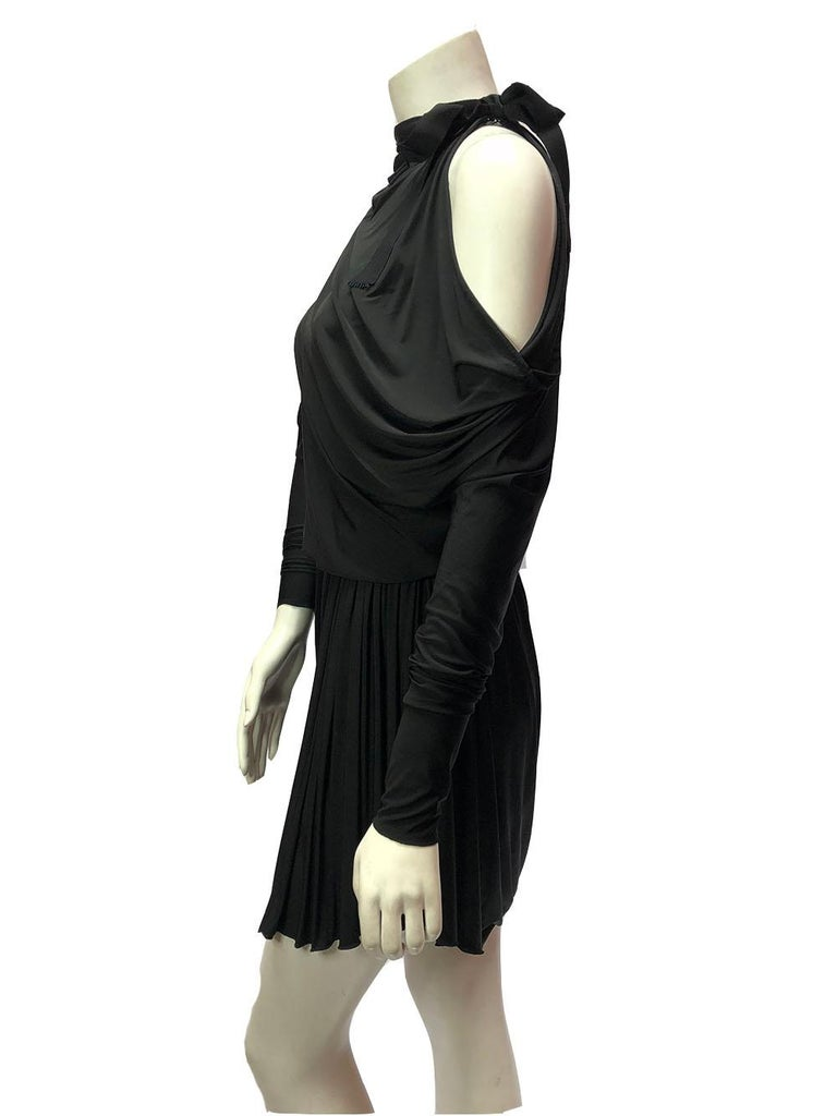 Draped black dress by Alexander Wang with open shoulders and tie neck. Elasticized waist to show off your shape. Size Small.