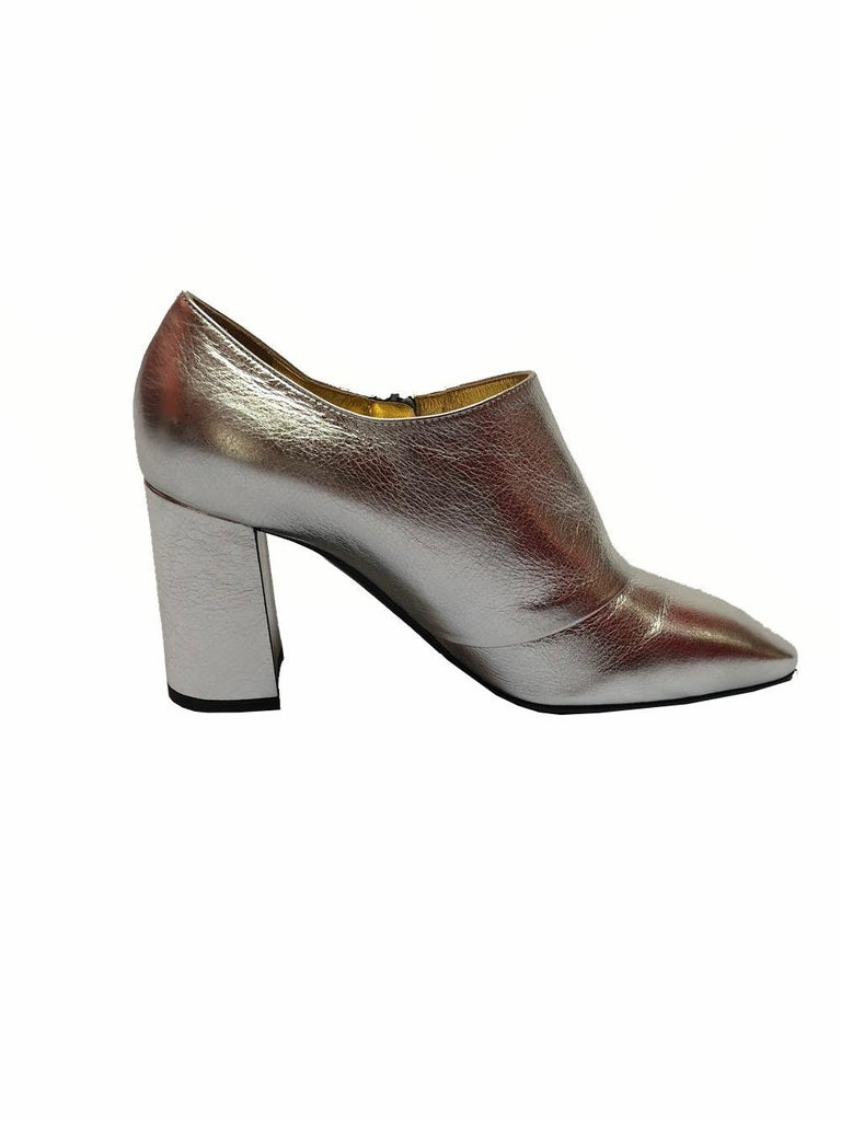 Silver ankle boot by Bottega Veneta with block heels and almond shaped toes. Original tags still attached, and comes with original box. Size 37. Retail value: $740.