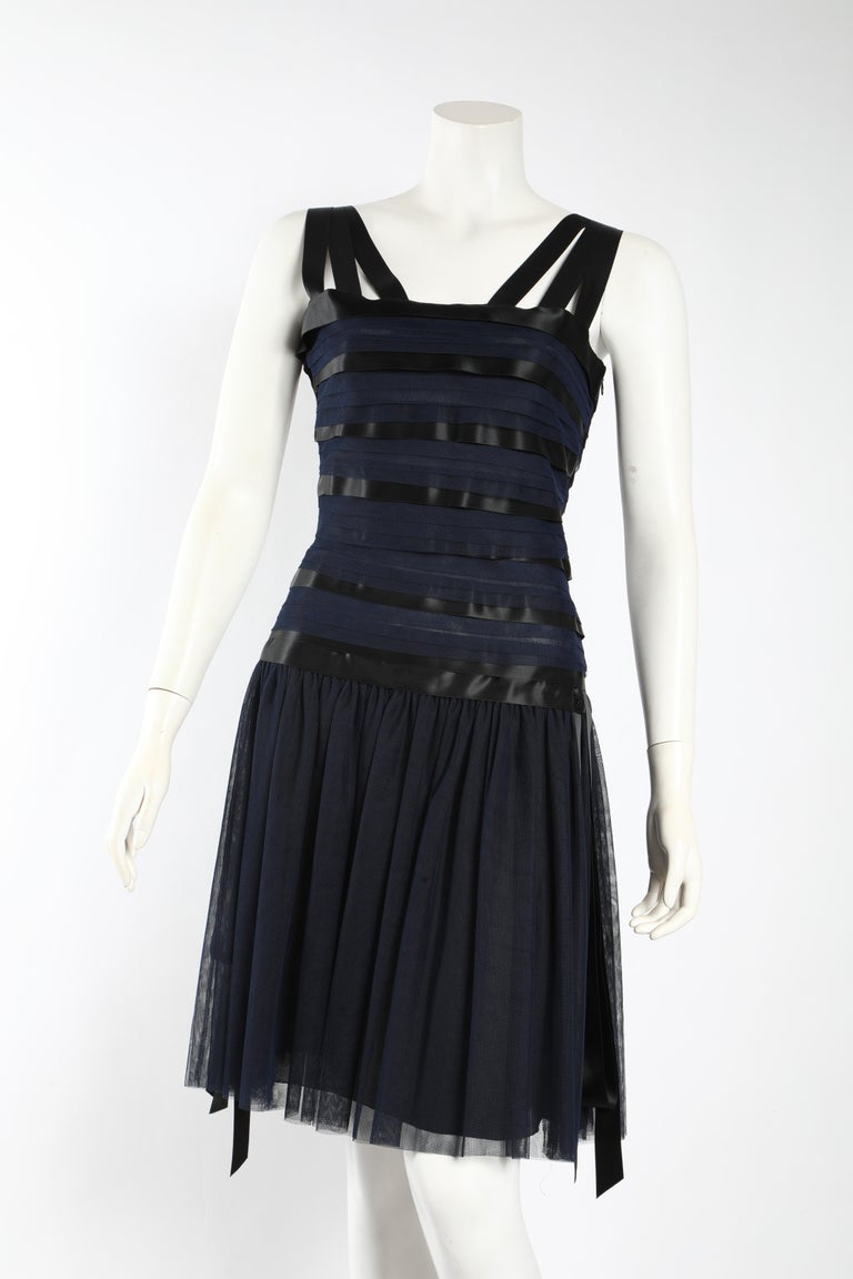 This gorgeous navy and black and ribbon Chanel runway dress is one of a kind.  Gorgeously classic, but a show stopper.   CHANEL 06A Runway Black silk ribboned dress with a square neckline and ribbon straps. The silhouette is a drop waist -  slim and