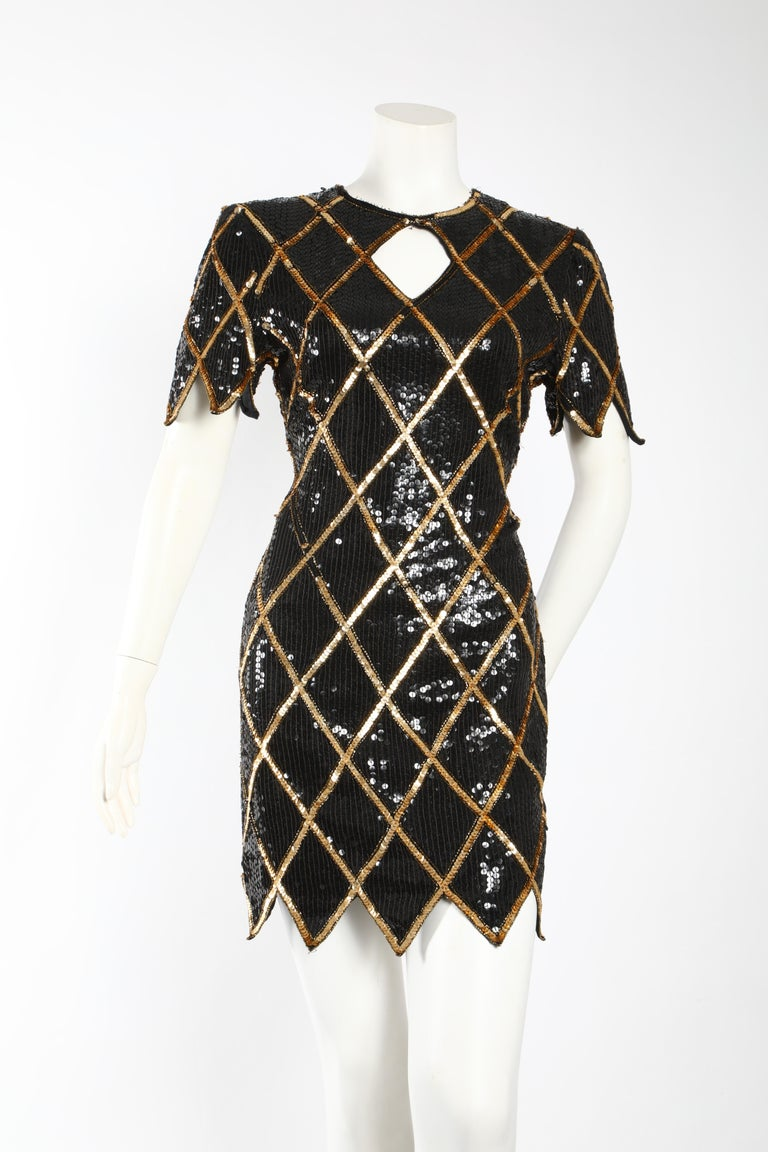 80s revival.  Scalloped short sleeves and bottom, this gold and black sequin cocktail dress is as relevant as can be right now. This flirty, sexy , vintage 80s dress is sure to get lots of compliments.   Size 42 (US 6)   Some sequins have fallen off