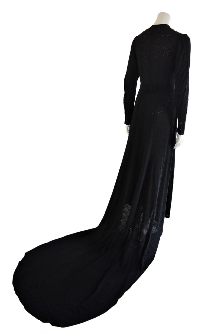 This vintage gown is a rare and beautiful piece. It is made from an embroidered fabric with small holes. It does not have any labels but the fabric feels like a kind of rayon. Fits like a size 4 / 6.  Before shipping, the gown will be sent to a