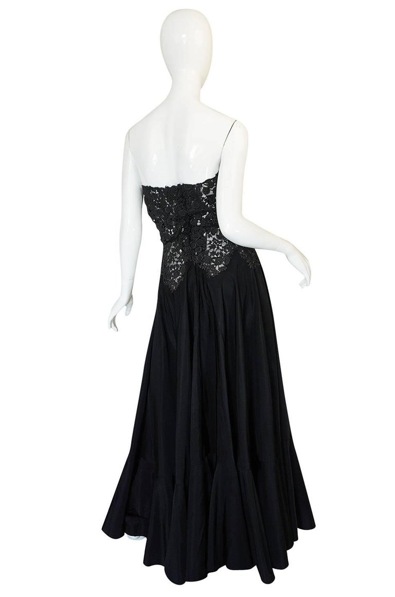 This is a rare and early Nina Ricci dress that is not perfect but still quite beautiful and important as it would have been made while she was the head of the atelier. It is constructed from a combination of a heavy black silk taffeta and a dense