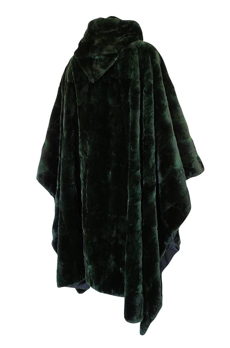 This hooded poncho or cape is wonderful. It's by Yves Saint Laurent and is a beautiful and easy to wear piece that will fit virtually any size. It dates the late 70s, maybe early 1980s and is a wonderful piece of the work he was doing using furs
