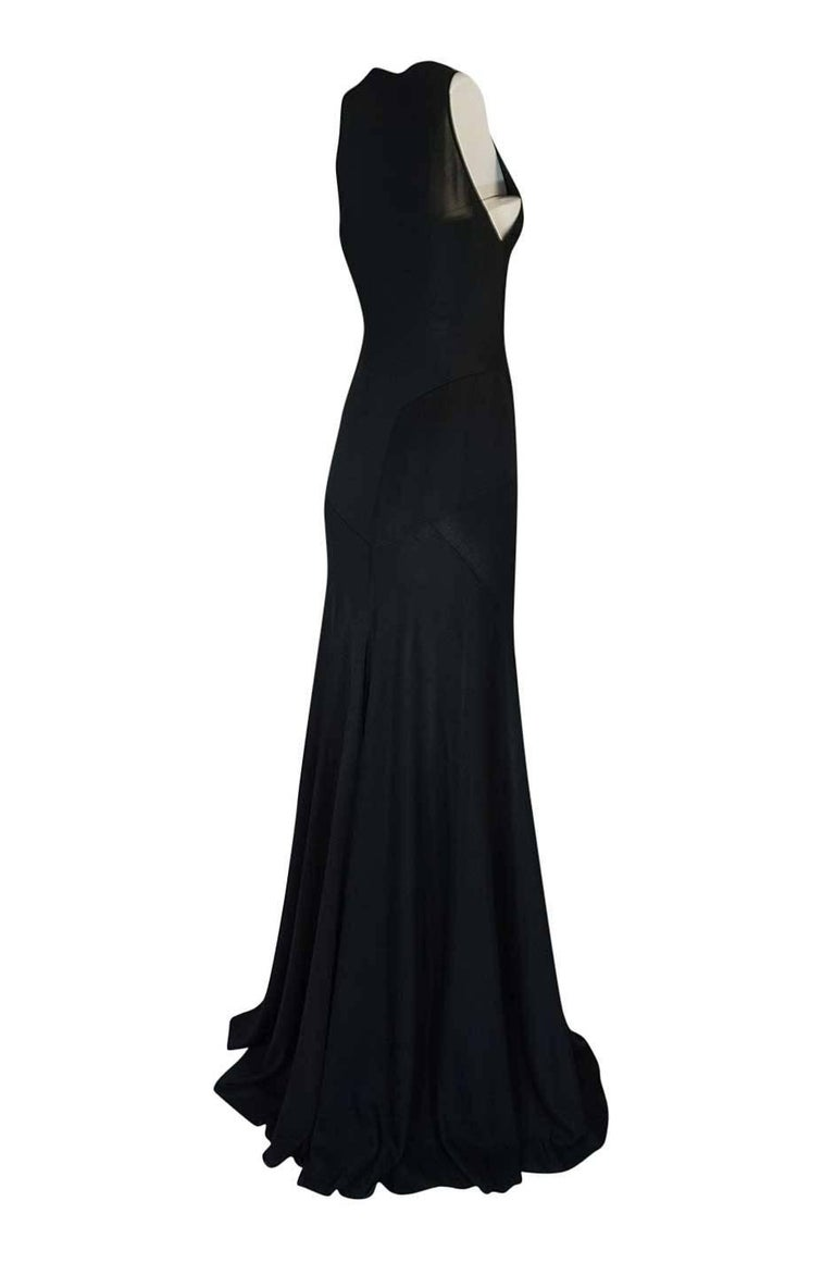 The twin of this dress walked the runway for the Fall/Winter 2001 presentation. The reference photo from that collection appears more of a blue but the runway version was black - it is just the lighting that makes it look that color. Versions of