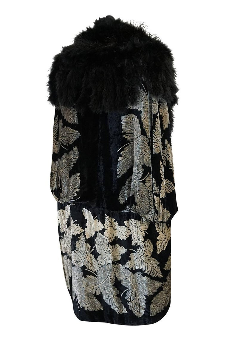 This cape is utterly amazing and a true work of art. It has a hand stenciled pattern of leaves running through the black silk velvet that gives it the feel of the work that masters like Fortuny and Gallenga were doing at the time. I have actually