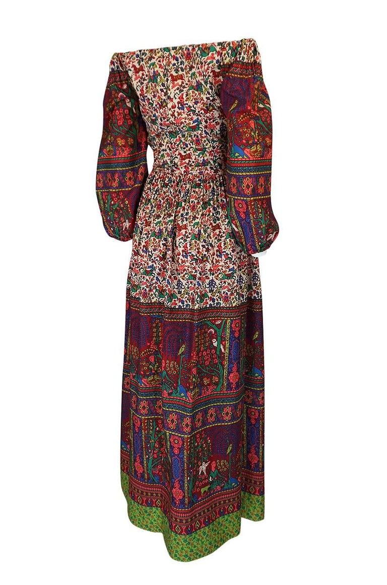 I absolutely love the exotic bohemian feel print and the cut of this dress. The combination of that beautiful printed silk mixed with the soft billowing cut make it quite a stunning piece. The bare shoulders also give the dress a very sexy feel. It