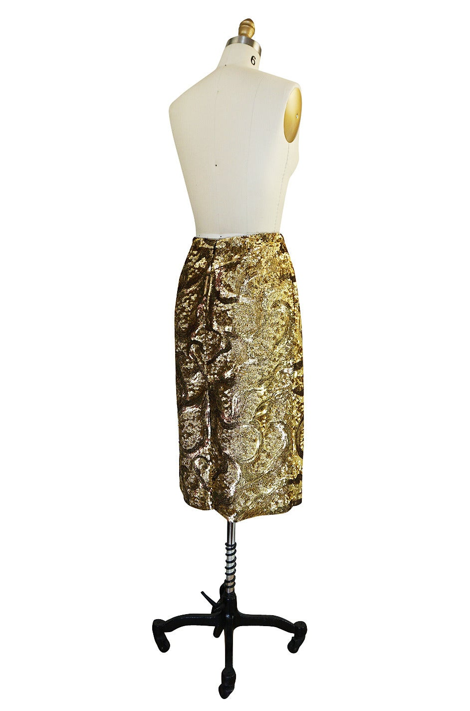 If you have been looking for that perfect statement skirt, look no further as this may well be it. From the 2014 Resort collection this muted gold, hammered sequin covered skirt is fantastic. Style dot com said of this collection: