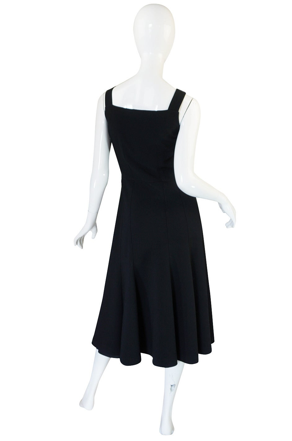 This wonderful black wool crepe Courreges dress can be worn on its own or styled in the manner of his signature look, with a top or turtleneck underneath. It is made from a light black wool crepe that moves well and is not heavy when on. It is cut