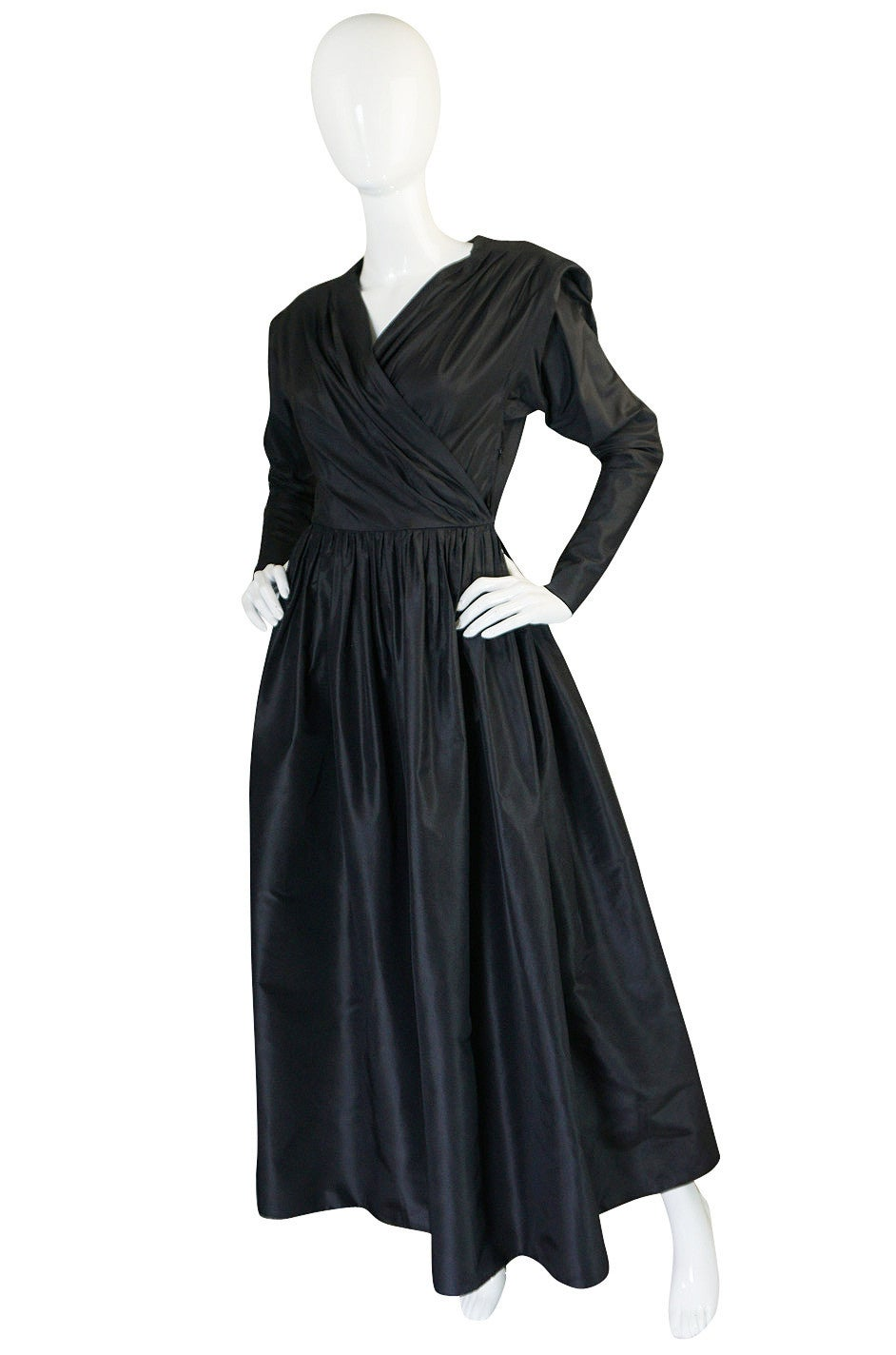 This is an exceptional silk taffeta, full length dress with a stunning cut and lines. It is just phenomenal. The skirt is very full and yet very light because of the fabric choice that allows it to retain the shape and fullness Yves intended. I love