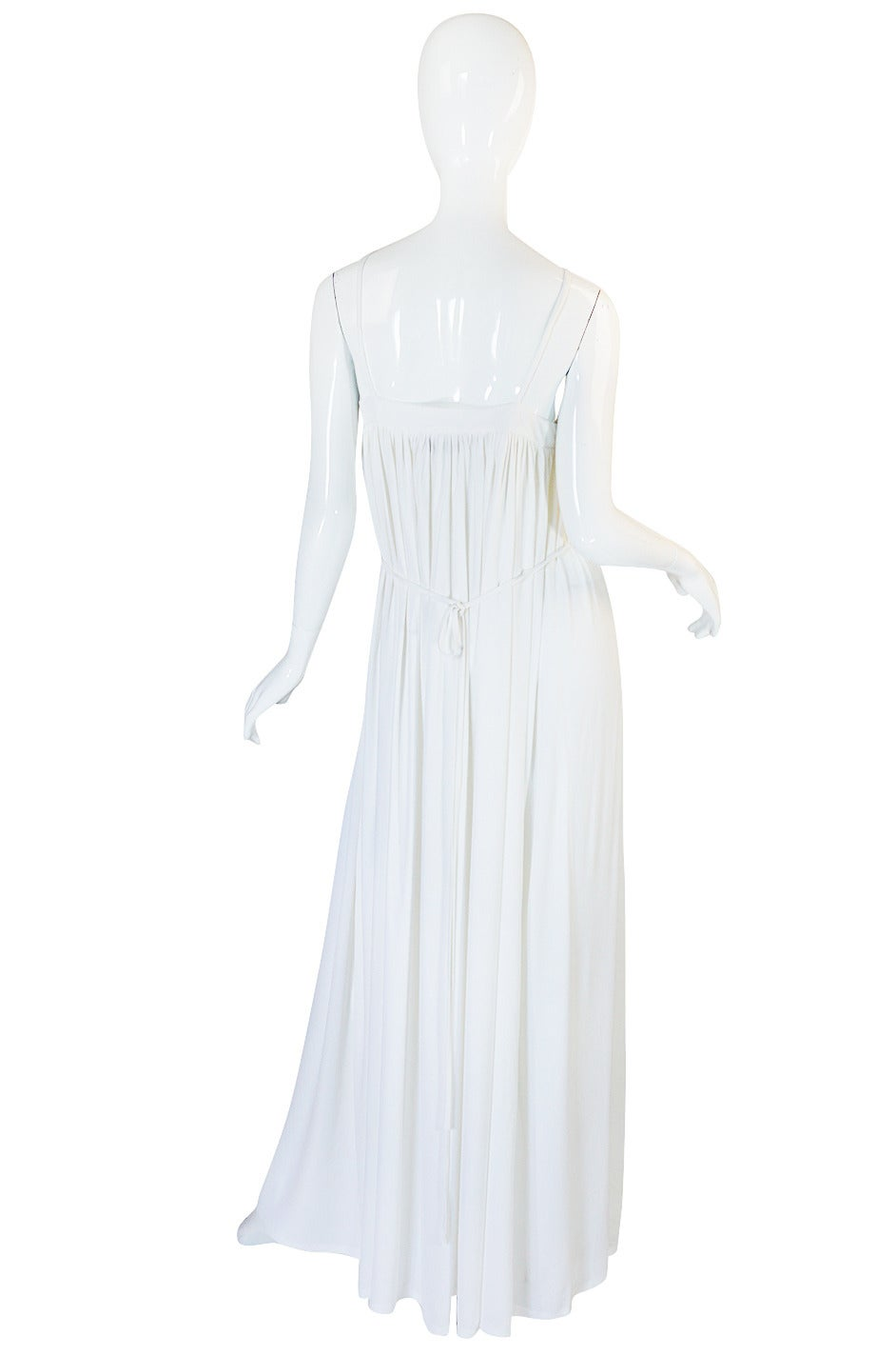 Supermodel length, spectacular silk jersey Quorum gown in a crisp, fresh white that is still pristine and looks unworn. This is so well made and feels so substantial and yet still slinky and sexy at the same time. It is a real marvel of construction