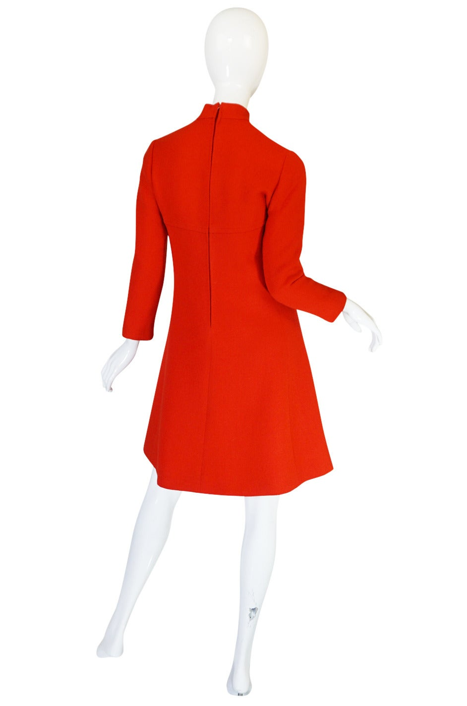 I love both the chic little lines of this dress and its amazing color! In person the color is a true bright vivid tomato red and really makes a statement. The choice of fabric adds to the depth of color - its a lightweight wool with a bit of texture