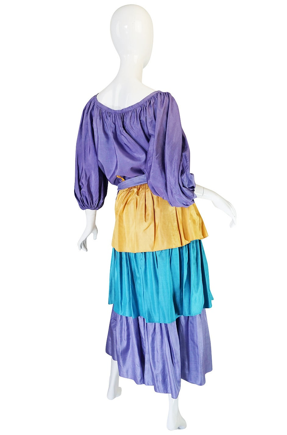 This stunning Yves Saint Laurent set clearly illustrates his love and fascination with all things gypsy, bohemian and peasant in feel while the color and fabric seem to give a nod to his famous love of color. This is like the perfect melding of the
