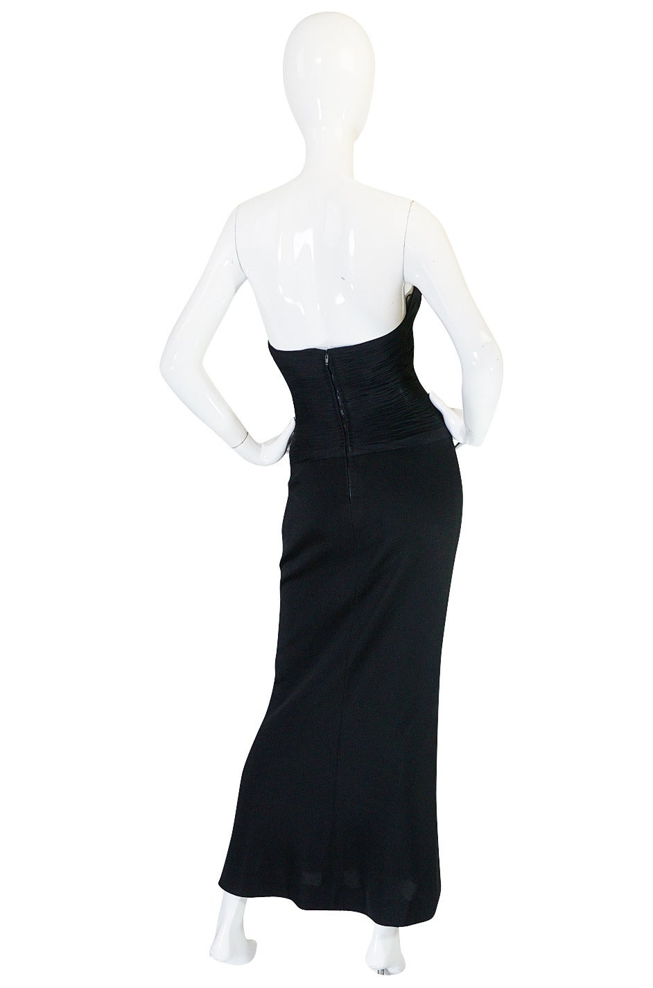 If you have been looking for in your face sexy, this late eighties Chanel dress might just fit the bill. It is made to be fitted, think follow every curve and give you some if they don't exist fitted. The skirt is made of a thick stretch jersey with