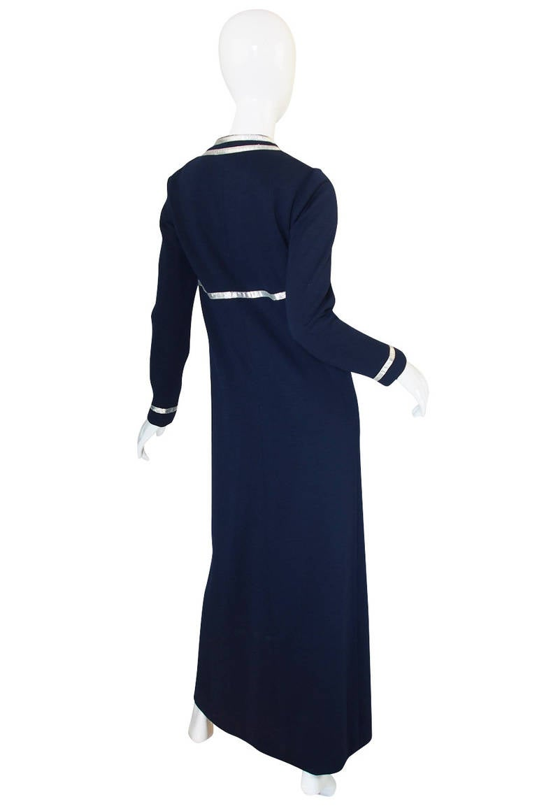 This navy and silver dress is a wonderful and early example of Geoffrey Beene's work and to me completely sums up the Beene aesthetic - a simple, almost monastic cut combined with  unexpected details and the bold use of graphic lines. This
