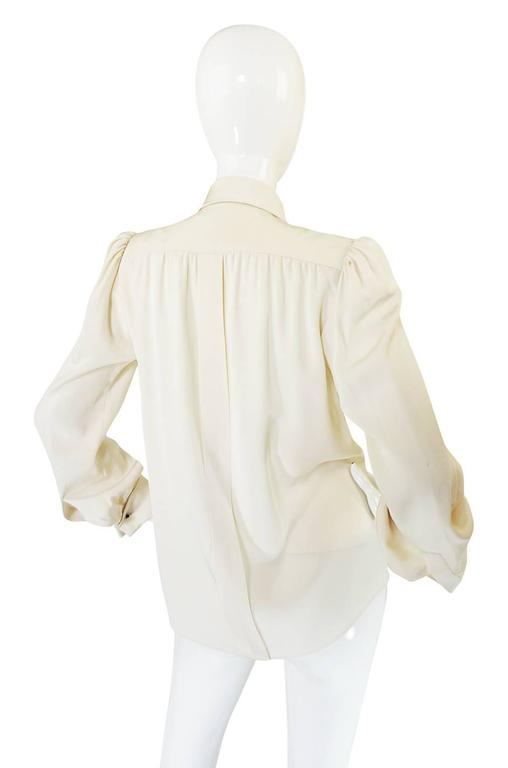 This beautiful silk blouse was produced and made by hand, under Yves Saint Laurent himself. It is a true treasure. Haute Couture is the very pinnacle of the fashion experience and I would hazard to say that vintage versions are even a little more