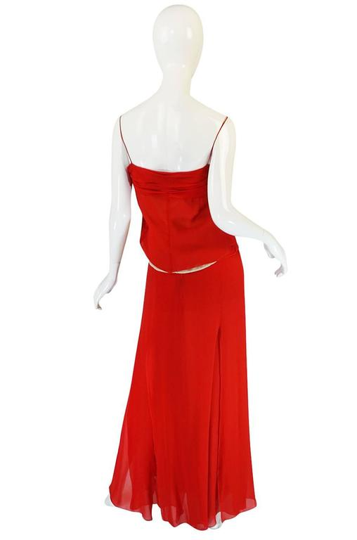 Valentino knows how to cut to perfectly flatter a woman's body and few can come close to the masterful techniques he perfected over the decades of his career. here we have a very sexy red silk chiffon halter top and skirt. It has that fresh and
