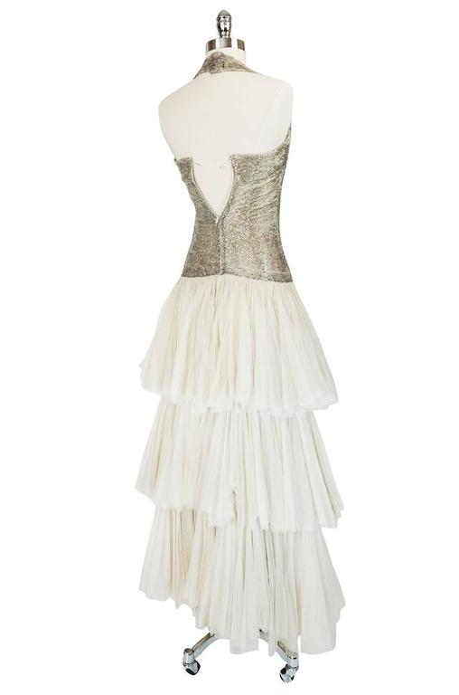 This gown is magnificent. I have never seen a gown from this period as pretty or romantic as this one and if not worn for a special event or winter gala, it could surely serve as a wedding gown for the bride looking to wear vintage. It is absolutely