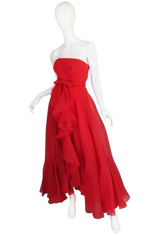 I love this dress with its explosion of ruffles and feeling of airiness. It feels like it just floats around you once on. The gown is a silk organza in a fabulous red. The fabric has a touch of a wavy ribbed texture to it making it very interesting.