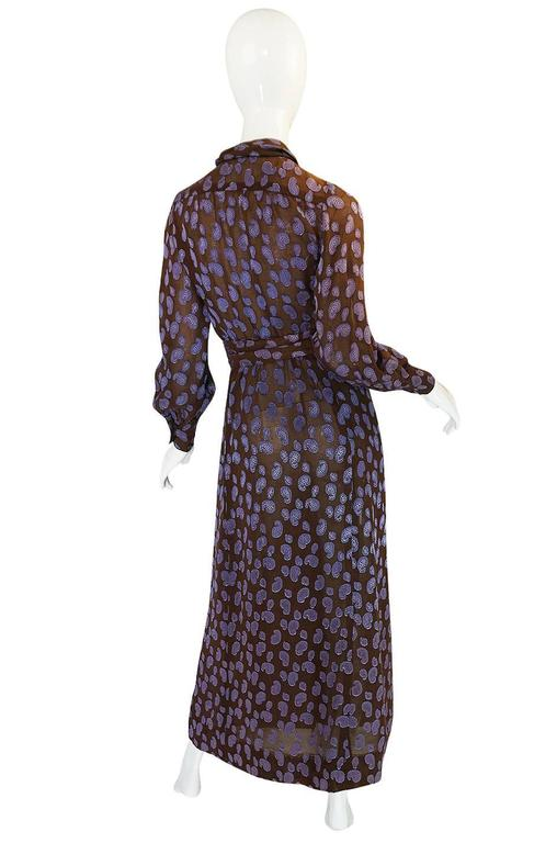 This is a gorgeous Givenchy dress made of an absolutely exquisite fabric. It is a chocolate silk voile that has had these little soft lavender bits of silk fused directly into the fabric. The very outer edges of the little purple bits have been left