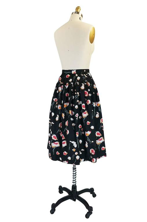 I love this fuller skirt by Yves Saint Laurent with its fifties feel and gorgeous floral print. It is made of a crisp cotton that has been printed with one of Yves signature prints. The waist cinches in and below that the skirt has a fabulous