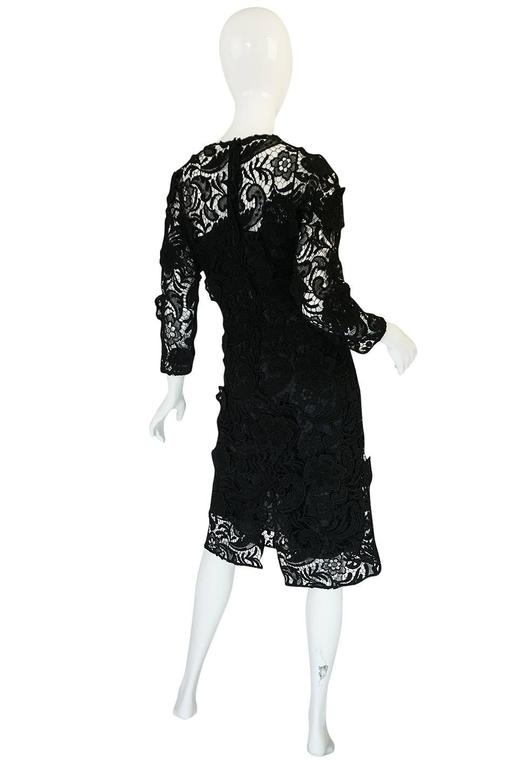 Yes, this is that lace dress from the Fall 2008 runway. When this came out it sold out before it hit the stores and was wait-listed world wide. And its still as good and wearable now. Maybe even more so as Miuccia always seems to design ahead of the