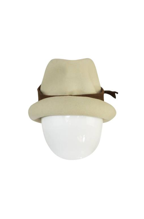 I am a little obsessed with this fedora by Christian Dior. It has a small, neat brim and sits at a jaunty angle once on. It is made of a felted wool and the band that circles the crown is an ultra-suede. The textures those two fabric have when