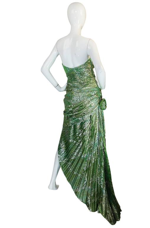 If you have been looking for a statement dress for the season look no further then this incredible Ungaro dress that is absolutely amazing. That dramatic color is the first thing you see - it's an amazing combination of green and gold and the
