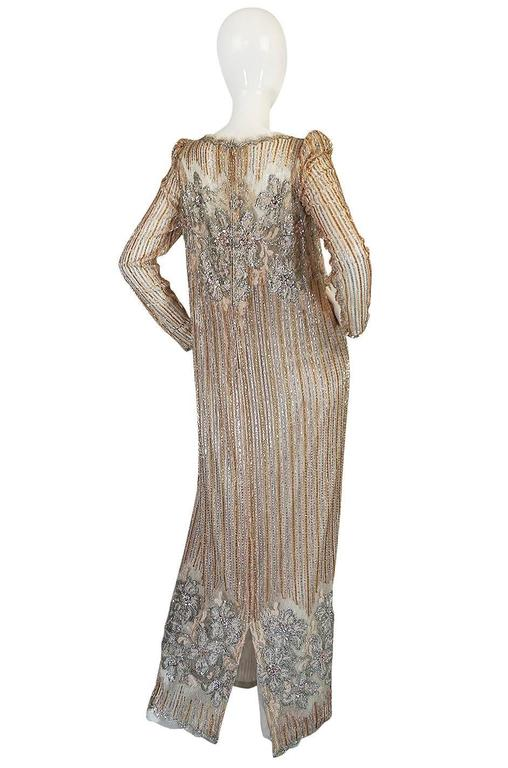 Fernando Pena was born in Spain and ended up based in Miami where he ran a small independent couture house. He was known for his bold and striking evening wear which, like this dress, were pure drama and showed his love for beading and glitter. This