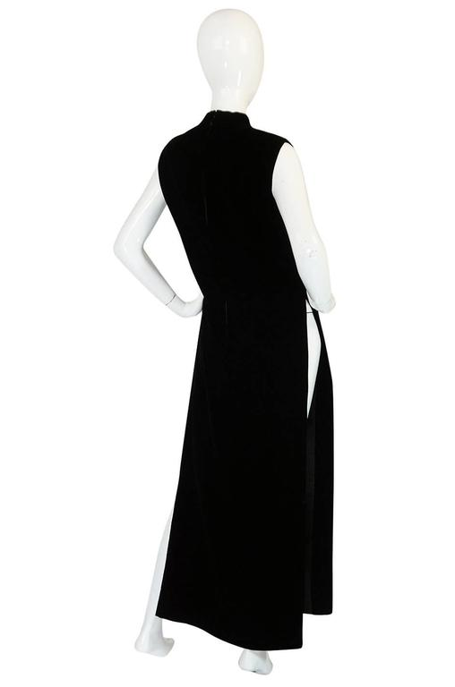 This 1960s Pierre Cardin dress is amazing. It is cut with scandalously high slits on each side making it more of a tabard in feel. This can be worn layered over something else whether it is as small and risque as a nude thong or a more conservative