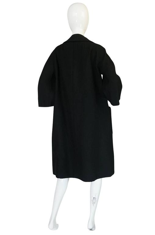 This coat is extraordinary and is beautiful and early example of Christian Dior's work. This is the Dior Original, New York label so is what is considered to be demi-couture from this time period of Dior's history. These where made in, and for, the