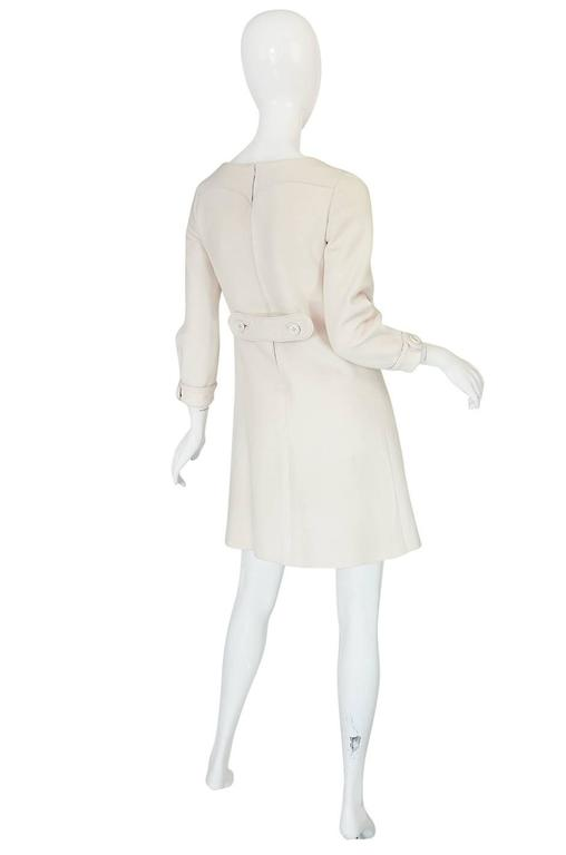 This very beautiful and perfectly cut couture dress from Courreges. Courreges spent 11 years as a cutter for Balenciaga before starting his own label and that high standard of tailoring shows in his garments. The fabric on this dress is exactly what