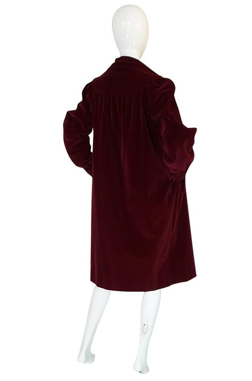 I love this great little Yves Saint Laurent coat that is made of a luxurious deep garnet colored velvet. I have had a couple of coats similar to this one before but each one I have had before this one had a Rive Gauche tag whereas this one has the