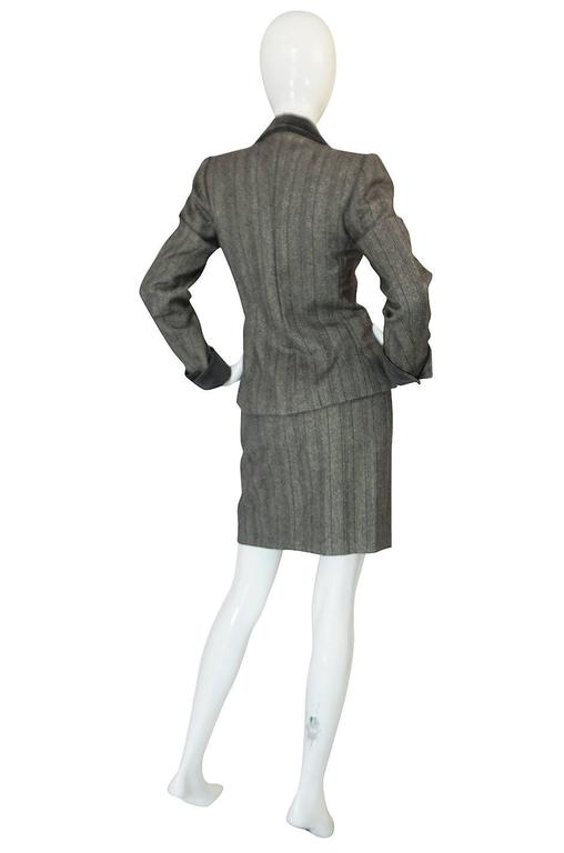 This is an amazing and classic feeling suit from the Yves Saint Laurent Haute Couture atelier. I have put that it as from the 1980s but the estate it came form was chock full of pieces dating form the late 1970s to the early 80s so it could be a