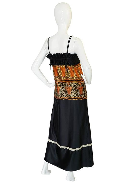 What a wonderful and dramatic dress this is. It would have been originally sold as a lingerie piece but it is opaque enough that in our modern world it can now easily be worn out as a proper dress. It is made of a fine synthetic silk that is hand