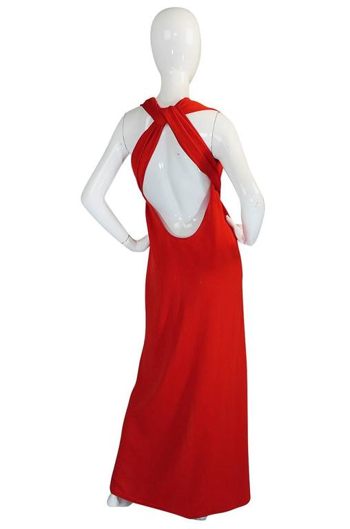 This little red jersey dress is really amazing if for nothing else but the sheer versatility it will provide to you. It is basically a tube of red jersey with a slit up one seam at the skirt and two mile long ties that extend up from that seam.