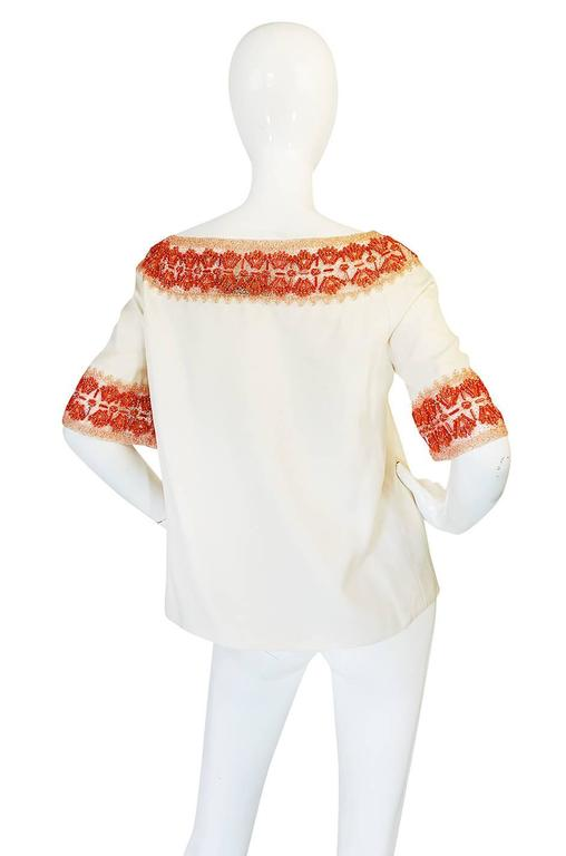 This is an extraordinary find. It is a stunning piece of Valentino with an extensive detailing of coral beading mixed with tube beads hand applied on silk netting and then used as detailing on the cream silk base. Valentino made this coral look