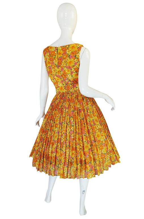 This little beautiful Suzy Perette dress is made of a beautiful light weight fabric with a floral pattern in an array of citrus hues. I have not found a really great Perette dress in ages and am so pleased to have such a fine example of her work in