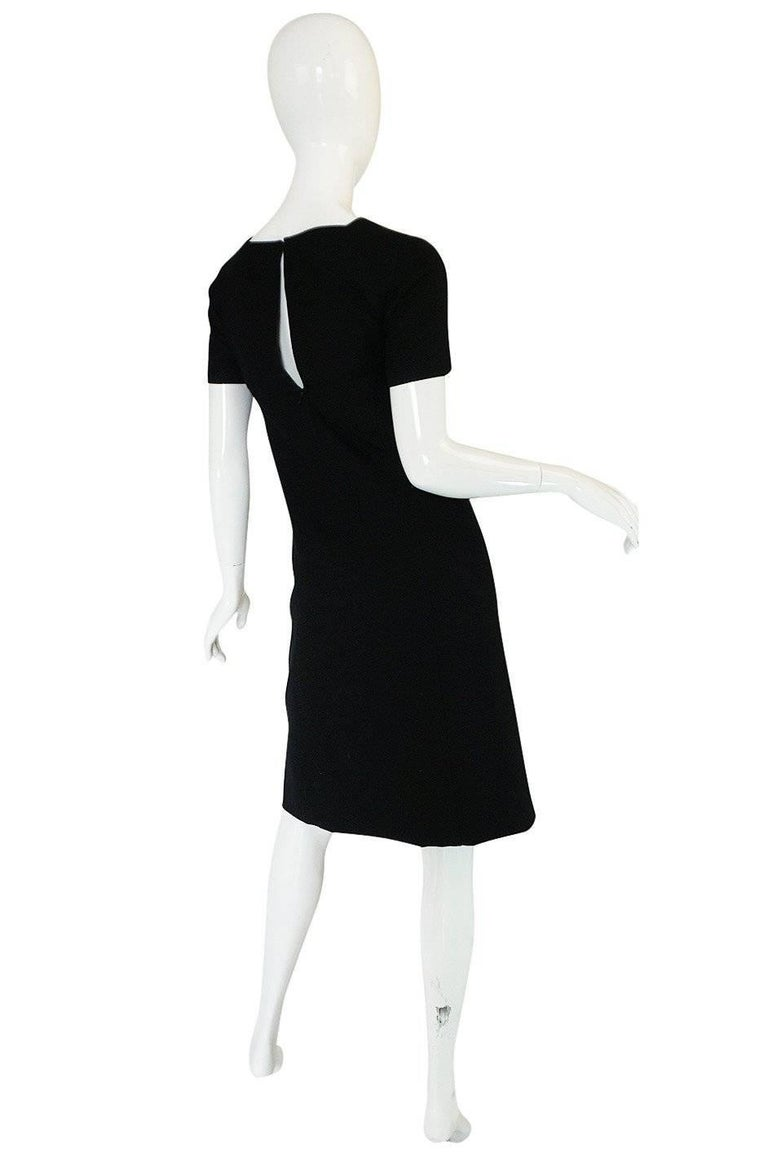 I have had the twin of this dress in the past and its as good now as the first time. This is a fabulous little black Courreges shift dresses and it is one of his classic designs. The fabric is jet black, light wool with a fine ribbed texture running