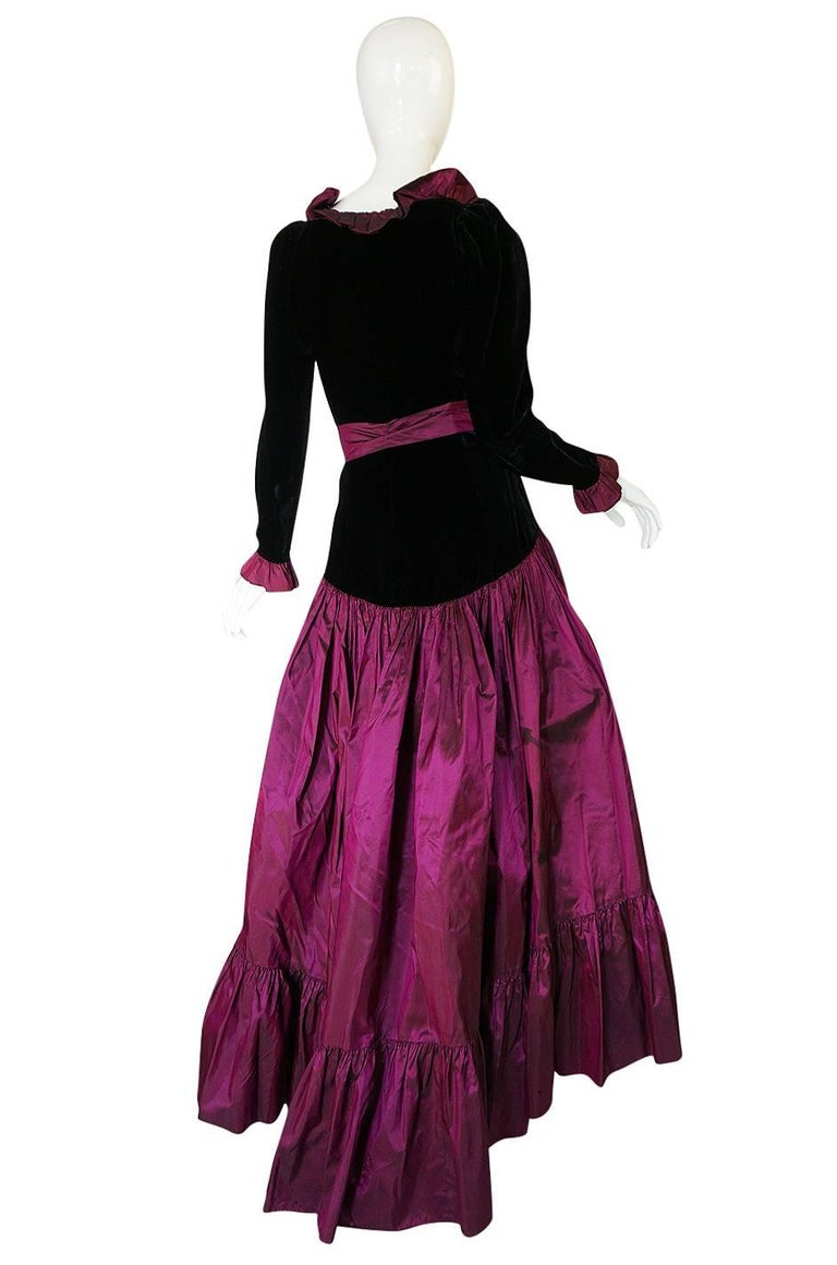 This is an exceptional iridescent silk taffeta and velvet, tiered and ruffled ball gown skirted gown by Yves Saint Laurent. A similar gown was shown for the 1979-80 Haute Couture collection by Yves with the same high low skirt treatment. That Haute