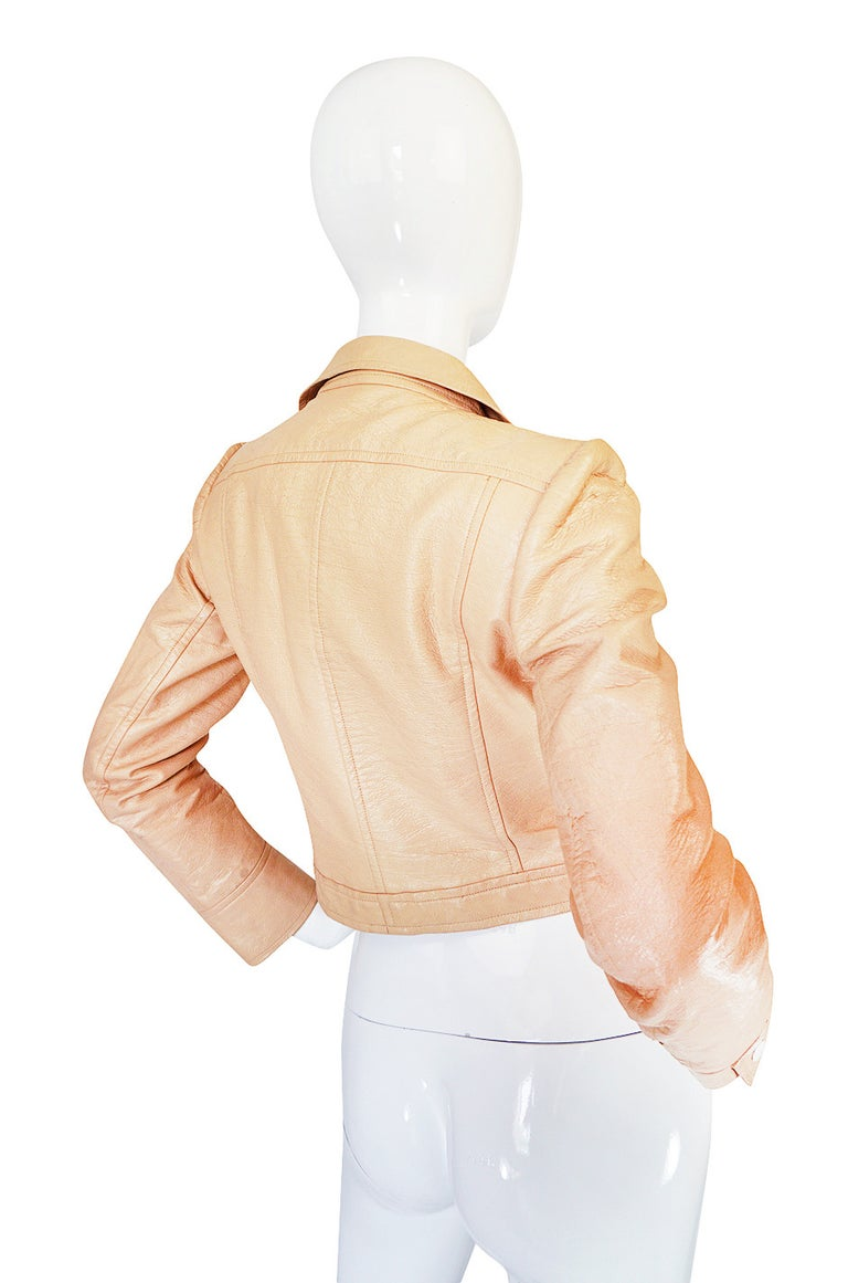 Andre Courreges made cloth and wool versions of this cropped jacket in 1968 and repeated versions of them for his next few collections as they were immensely popular. For the 1971-72 collection he did them in vinyl and showed them over ribbed under