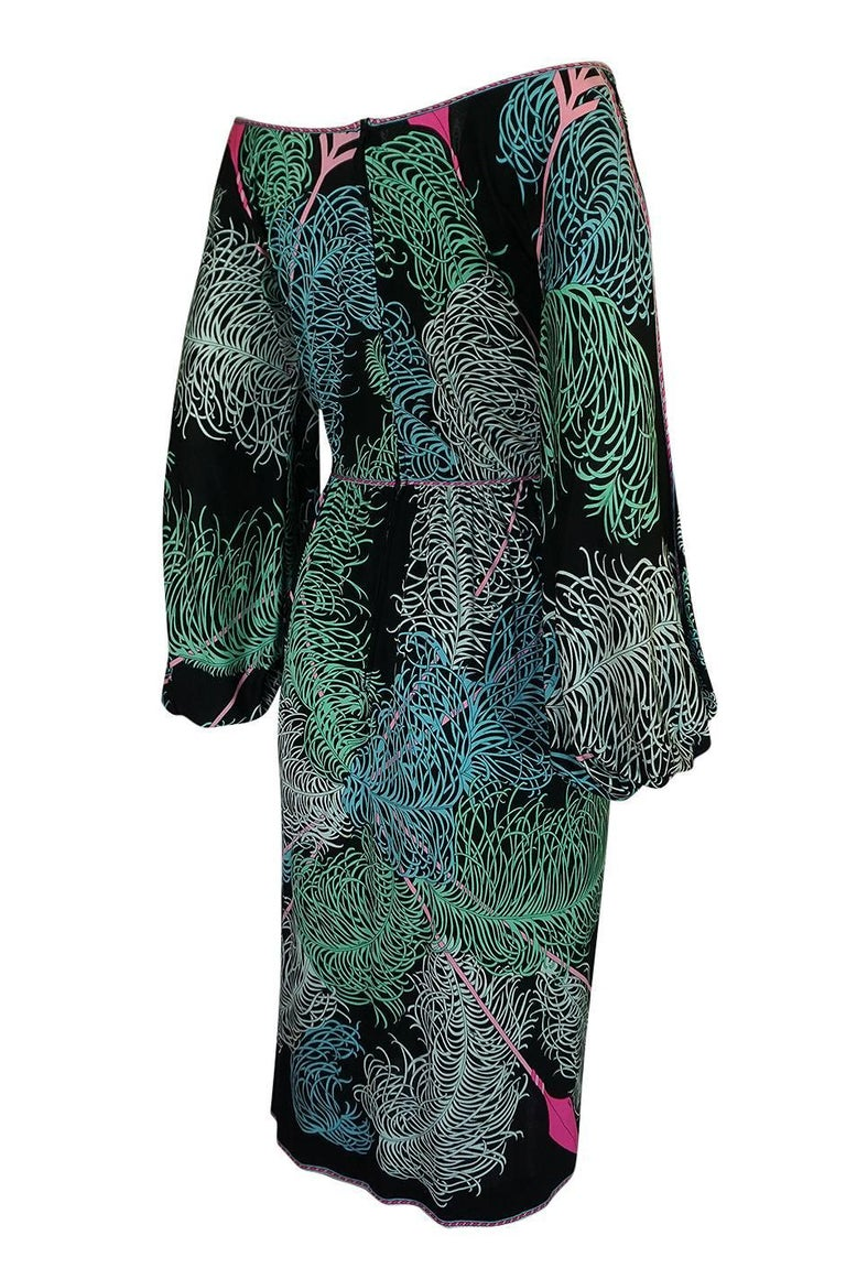 The cut of this dress is not typical of Emilio Pucci's work but I wish it was as its very feminine and flattering. It is cut loose and easy through the bodice with ties at the neck that you can tie at the front or wrap and cross up and around the